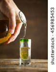 pouring tequila into shot glass.... | Shutterstock . vector #456985453