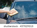 cleaning the car glass with... | Shutterstock . vector #457029313