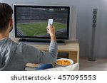 young man watching television... | Shutterstock . vector #457095553