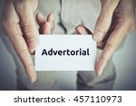 Small photo of Advertorial - on card hold by man