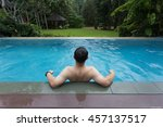 man lean on the edge of pool... | Shutterstock . vector #457137517
