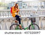 Young Female Traveler Sitting...