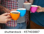 People Holding Coffee Cups