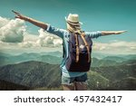 woman hiking in mountains at... | Shutterstock . vector #457432417
