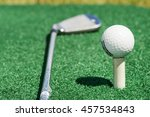 stick lying near golf ball | Shutterstock . vector #457534843