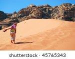 little girl climbs a dune. wadi ... | Shutterstock . vector #45765343