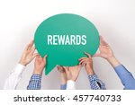 Small photo of Group of people holding the REWARDS written speech bubble