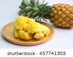 pineapple fruit cut on wooden...   Shutterstock . vector #457741303