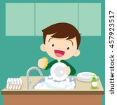 cute boy doing dishes.teenage... | Shutterstock .eps vector #457923517
