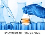 flask in scientist hand with... | Shutterstock . vector #457937023