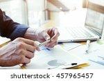 businessman holding pen... | Shutterstock . vector #457965457