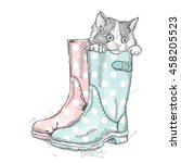 cute kitten sitting in a boot.... | Shutterstock .eps vector #458205523