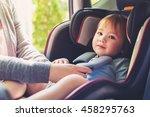 toddler girl buckled into her... | Shutterstock . vector #458295763