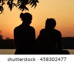 Silhouette Couple In Love At...