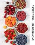 various fresh fruits in bowls... | Shutterstock . vector #458383657