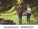 a couple hikers hiking with... | Shutterstock . vector #458402227
