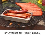 Grilling Sausages On Barbecue...