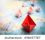 paper boats following a red... | Shutterstock . vector #458457787