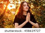 the girl prays in nature. eyes... | Shutterstock . vector #458619727
