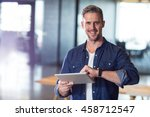portrait of smiling man holding ... | Shutterstock . vector #458712547