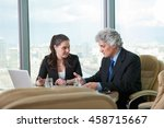 mature businessman and young... | Shutterstock . vector #458715667