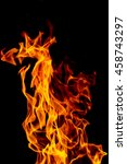 Small photo of yellow, orange and red and red Fire flame /ablaze isolated on black isolated background