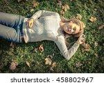 woman listening music on grass... | Shutterstock . vector #458802967