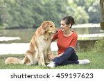 woman relaxing with dog at the... | Shutterstock . vector #459197623