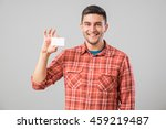 young man holding and showing... | Shutterstock . vector #459219487