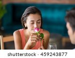 woman smelling a rose offered... | Shutterstock . vector #459243877