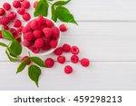 Red Fresh Raspberries On White...