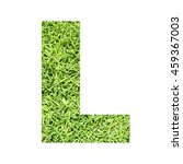 Small photo of The outline of English capital letter 'L' isolated on white background and filled in with actual photo of green grass lawn with applicable clipping or working path for design project
