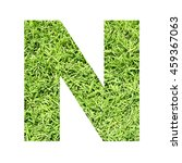 Small photo of The outline of English capital letter 'N' isolated on white background and filled in with actual photo of green grass lawn with applicable clipping or working path for design project