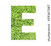 Small photo of The outline of English capital letter 'E' isolated on white background and filled in with actual photo of green grass lawn with applicable clipping or working path for design project