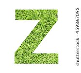 Small photo of The outline of English capital letter '' isolated on white background and filled in with actual photo of green grass lawn with applicable clipping or working path for design project