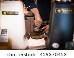 barista using a tamper to press ... | Shutterstock . vector #459370453