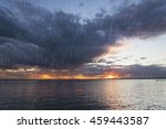 rain over the lake at sunset | Shutterstock . vector #459443587