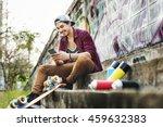 Teenager Boy Texting Skateboar...