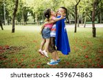Small photo of Adolescent Siblings Playful Park Concept