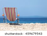 vintage beach chair on the beach | Shutterstock . vector #459679543