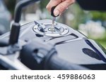 hand the key open tank cap... | Shutterstock . vector #459886063
