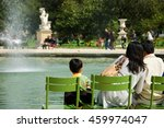 Family Relaxing In Tuileries...
