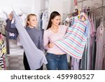 two female customers selecting... | Shutterstock . vector #459980527