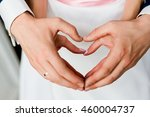 couple making a heart out of... | Shutterstock . vector #460004737