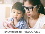 mother teaching her child to... | Shutterstock . vector #460007317