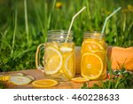 Two Glass Jars With Lemonade O...