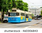 Small photo of Goteborg, Sweden - July 25, 2016: Blue and beige tram in central city. The electric trams are run by Vasttrafik and transport commuters all over town with zero emission.