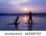 silhouette of two boys jumping... | Shutterstock . vector #460389787