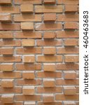 Small photo of Salient or protruding arrangement red brick wall texture at intervals. Interesting background.