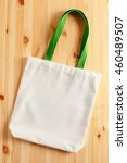 white fabric tote bag on wood... | Shutterstock . vector #460489507